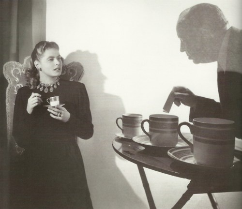 Ingrid Bergman with Alfred Hitchcock on the set of Notorious having a coffee break