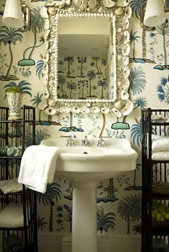 The wallcovering & the shell mirror both have that tropical feel. I'm glad they have the little etageres to hold things, but I still would prefer a nice cabinet to store things out of sight & a countertop for your daily necessities. via ~ Belclaire House blog ~