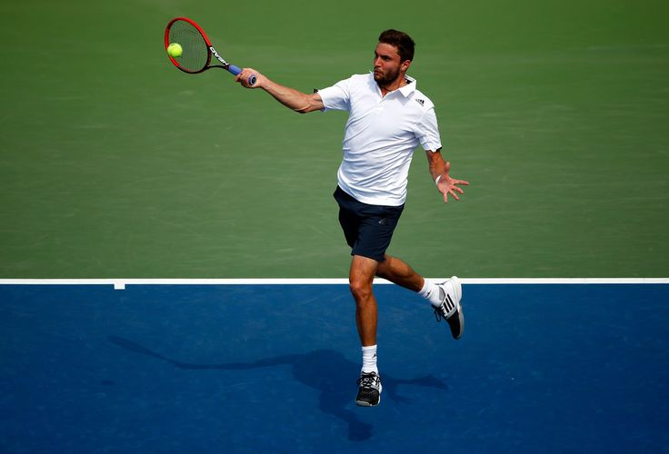 Gilles Simon of France returns a shot to David Ferrer of Spain Photos: 2014 U.S. Open - Day 7