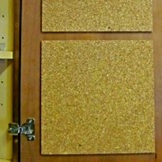 Need a kitchen bulletin board? Attach sticky back cork tiles to the inside of a kitchen cabinet door and you can get everything organized.