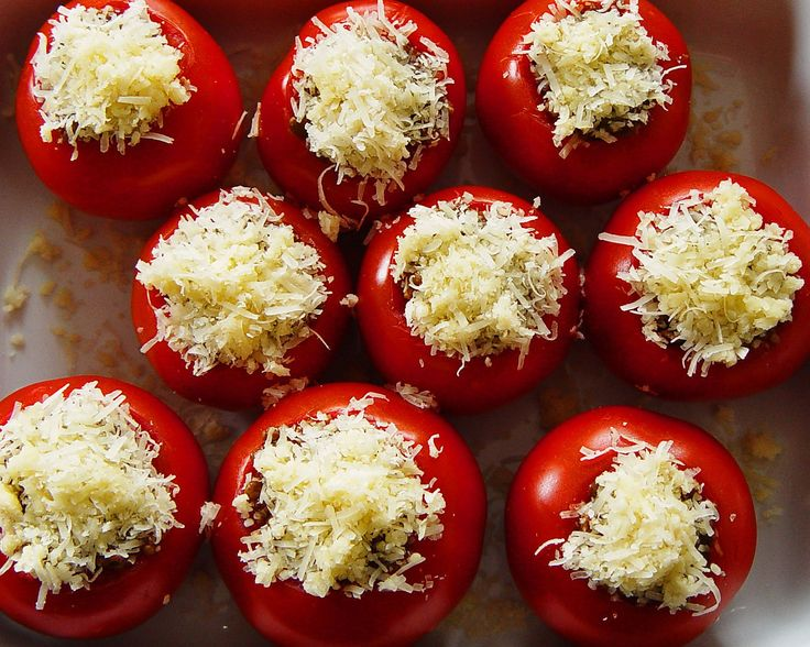 A homemade vegan stuffed tomato recipe filled with a rice and veggie mixture and topped off with a bit of vegan cheese. Vegan stuffed tomatoes can be served as an appetizer, side or main dish.