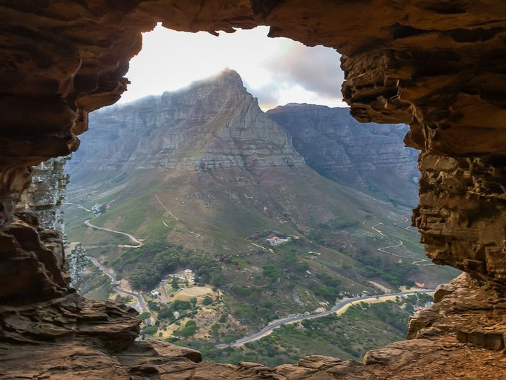 Wally's Cave! Situated on the side of the mountain facing directly onto the Table Mountain Cable Station, Wally's cave is deep enough to protect you from wind and rain, but if you're looking to take a photo from inside this cave, be sure to pack your widest lens or GoPro to capture it because the wider you go, the better! Cape Town, South Africa.