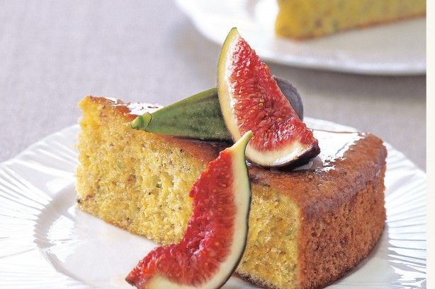 This deliciously sweet fig and pistachio cake is a gluten-free delight. Serve it decorated with fig wedges and drizzled with extra fig and orange syrup.