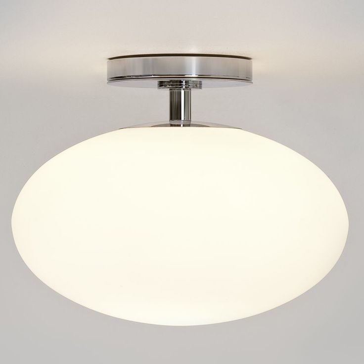 The astro zeppo bathroom ceiling light has a frosted glass shade and a polished chrome fitting