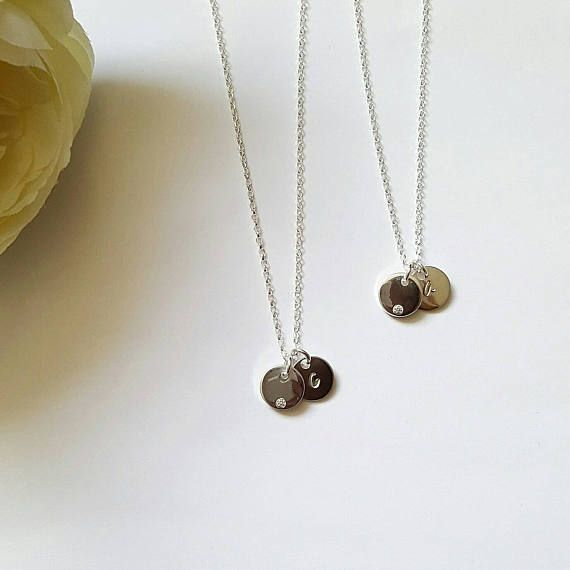This beautiful Cubic Zirconia Sterling Silver disc necklaces makes a perfect, personal gift for that special someone. The Cubic Zirconia discs can come on their own or additional personalised sterling Silver discs can be added and personalised with any lowercase initial, number or heart. Necklaces come in a lovely little silver gift box so no need to go out and buy one. Disc size: 10mm sterling silver. Chain length optional (Please see drop down menu) All Sterling silver diamond cut belcher…