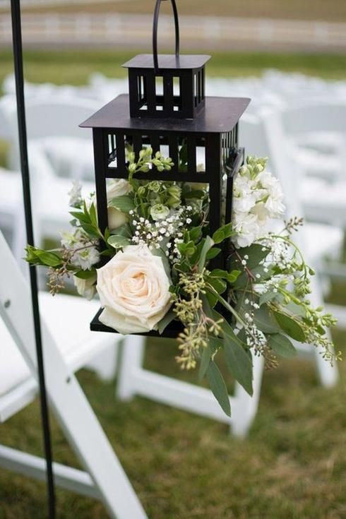 Lanterne remplie de fleurs pour mariage