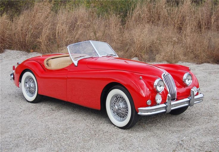 1956 Jaguar XK Roadster -just saw a brand new Jaguar on my way home. The original owners and designers are rolling in their graves right now...there was a Ford Taurus in the lane next to it, and I think the Taurus looked better :-(