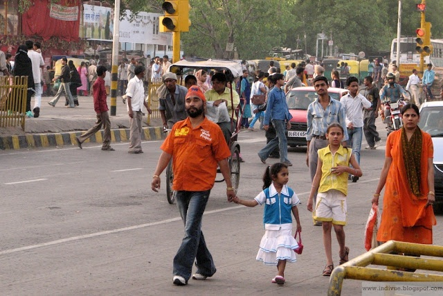 Proud father walking with his daughter in the center of Delhi, India