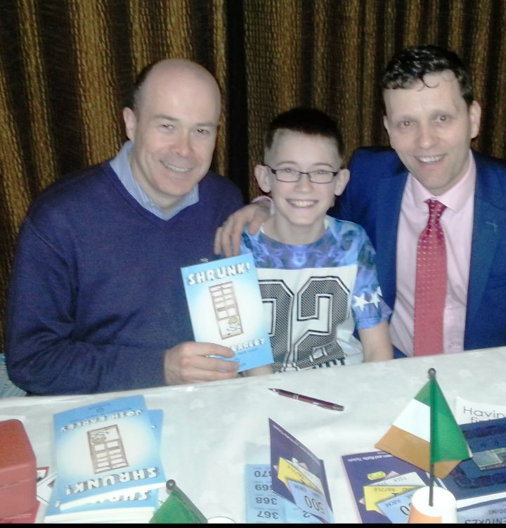 TD, Denis Naughten with young author, Josh Earley and Dr. Niall McElwee of Book Hub Publishing.
