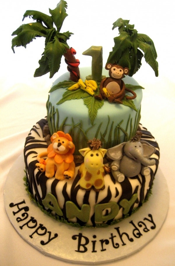 Cute Jungle Birthday - have Young Tarzan on top...and his friends on the bottom? it's an idea :)