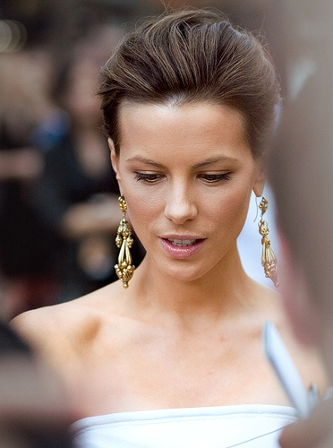 Love the hair back and poofy with big earrings look. Perfect with a long flowy dress. =)