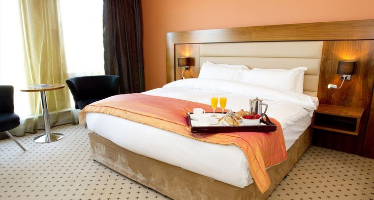 Our superior double rooms are beautifully furnished in modern warm tones