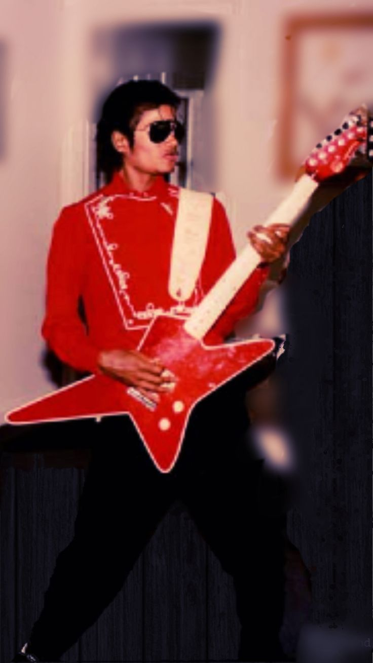 Michael got Prince back for stealing his umbrella.... He stole his guitar.