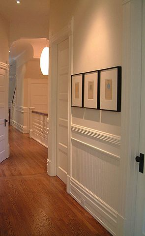 Beautiful hallway in a San Francisco Edwardian home - the period look of the molding can be recreated using board and multiple pieces of decorative trim. In this case, the large chair rail was created using board in the middle, cap molding on the bottom, and molding on top. The base molding is built the same way.