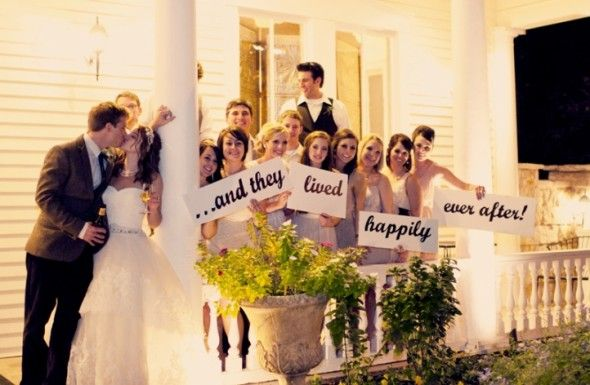 "Cute wedding picture idea with signs that say, ""...and they lived happily ever after"" {Wedding Photography} {Bride and Groom} {Bridal Party}"