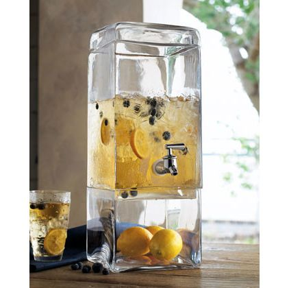 The clear base in this modern beverage dispenser allows you to display fruit, flowers, seashells or other decorative items to enhance your summer tablescape.