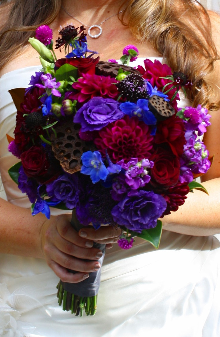 Jewel Tone Brides Bouquet Burgundy Purple And Blue Flowers With Added Texture Form Lotus Pods