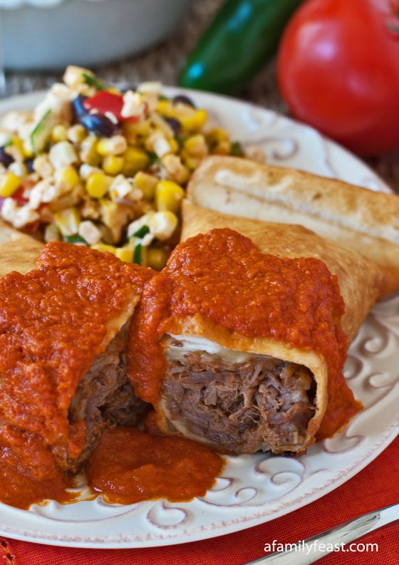 Beef Chimichangas - A filling of fork-tender Mexican shredded beef and a blend of cheeses in a crispy tortilla shell. So delicious!