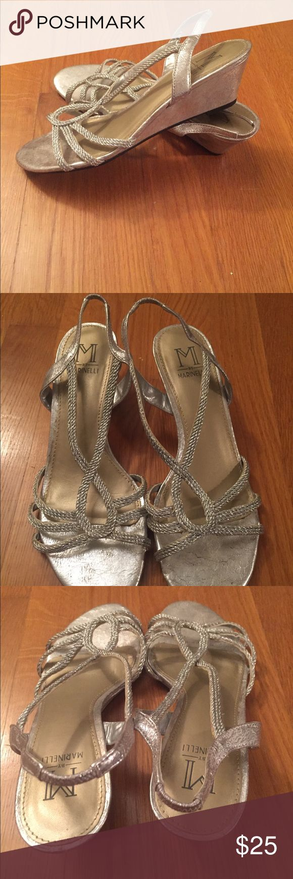 Silver wedge sandal Worn on one occasion as this was a bridesmaid shoe. Elastic on back of heel strap. Metallic silver. Still in good condition. Main wear is on the bottom of the sole. A. Marinelli Shoes Sandals