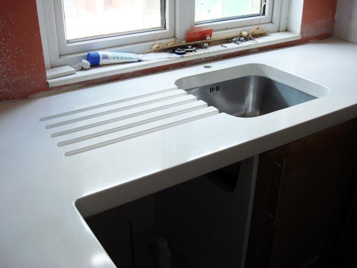 white concrete countertops. love the drainboard!