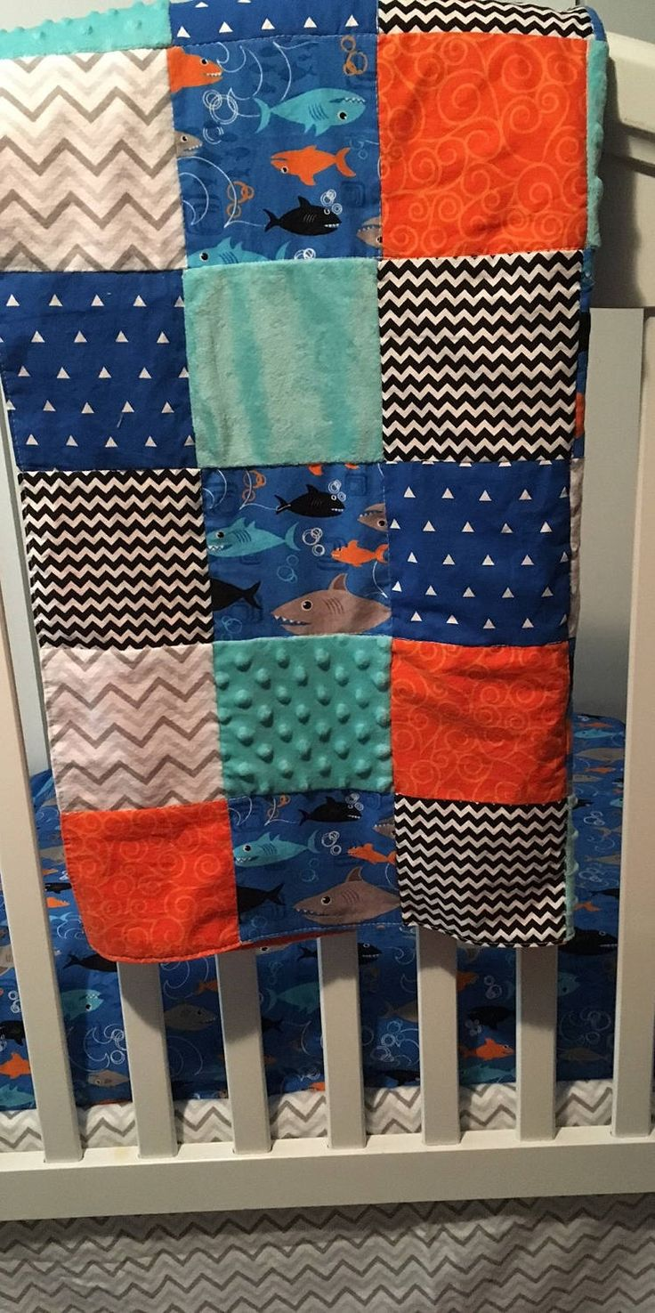 This adorable nautical crib bedding is perfect for any little boys nursery or a great gift for a new baby. The crib bedding is a mix and match set. You pick the minky color for the back of the quilt, fabric for a cotton crib sheet, the crib skirt & the rail guard fabric. Fabric