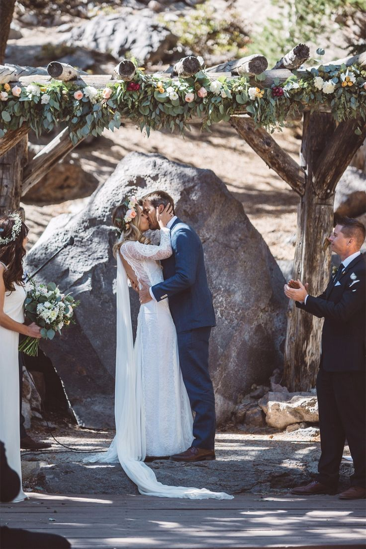 Mountain wedding in a long sleeve lace wedding dress by Grace Loves Lace