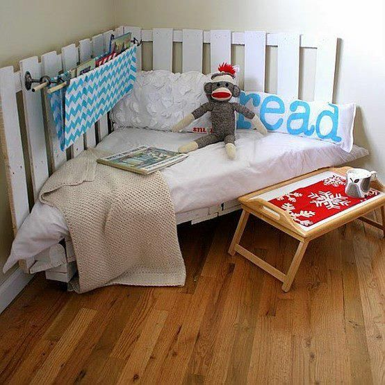 Isn't this a great space for kids to curl up and read or enjoy another quiet activity?    A useless corner, a few old pallets painted, a piece of foam cut to size and some soft furnishings and you can get this result, for very little money.    What do you think of it?