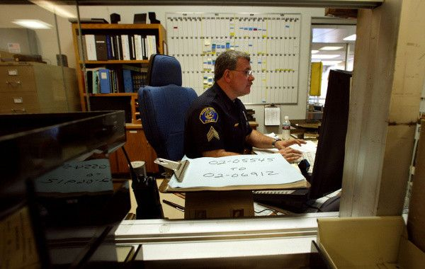 In this 2002 photo, Buena Police watch commander Sgt. Phil Dascenzi does his job in a cluttered room at the Buena Park Police facility, built in 1963. The building will come down to make way for a new recreation center expected to open by the end of 2011.