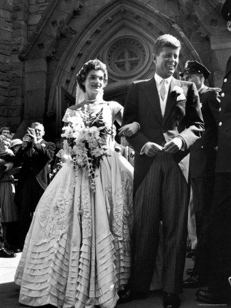 After a year-long courtship and a three-month engagement, Jacqueline Bouvier, 24, and Sen. John F. Kennedy, 36, are wed on Sept. 12, 1953, at St. Mary's Church in Newport, R.I.