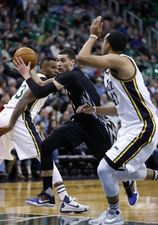 Minnesota Timberwolves guard Zach LaVine (8) drives to the hoop against Utah Jazz forward Trey Lyles (41) in the first quarter at Vivint Smart Home Arena.  #9223267