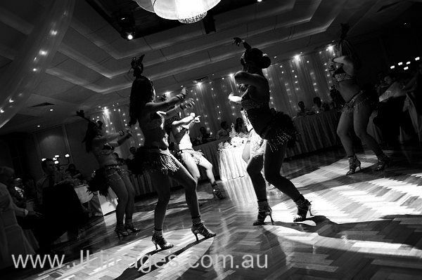 Dinner and a show! Check out this reception filled with entertainers and dancers. #jlimages #weddingphotography #dancers #entertainment #reception