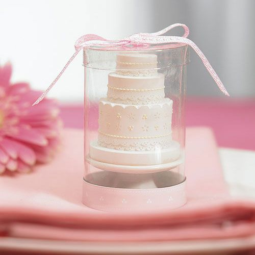 elegant-lace-wedding-cake-candle-in-clear-box-and-ribbon-displayed-on-table-napkin