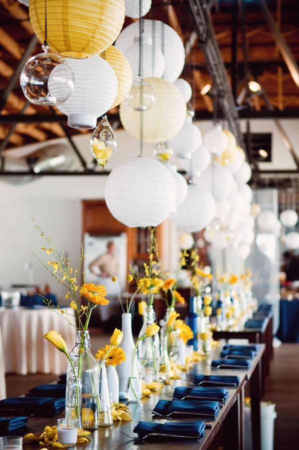 Navy, yellow, white. Over stage/over food area.  Globes $5/piece.  Hanging small clear vases also.
