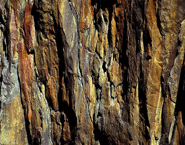 A must see on New Zealand's South Island is Milford Sound. I shot this image of a sheer cliff wall at Copper Point in Milford Sound from a cruise ship on a spectacularly sunny and cloudless day in one of the rainiest places on earth. Copper Point is named after the veins of copper you can see running through the rock. #rock, #abstract, #copper