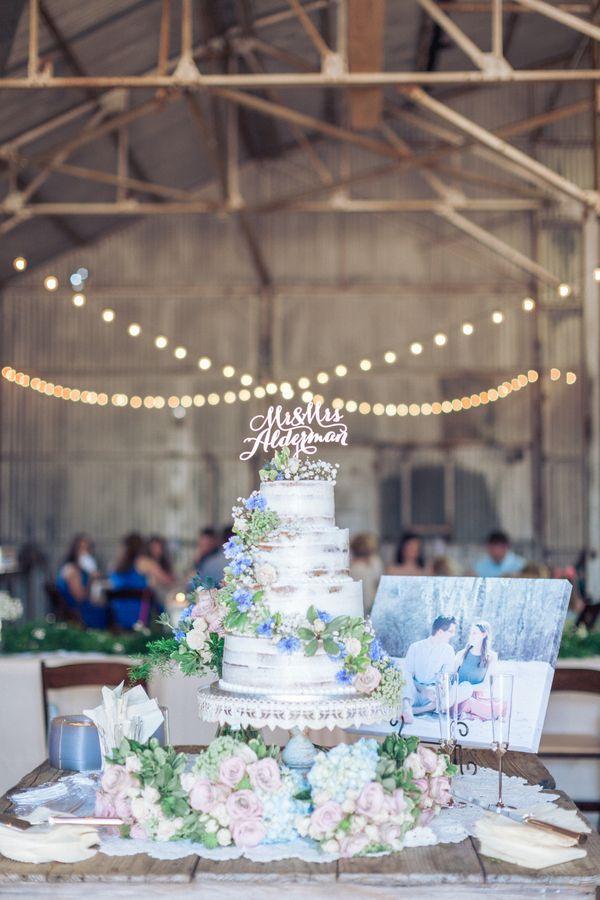 Cute rustic wedding cake table! View the full wedding here: http://thedailywedding.com/2016/07/31/romantic-rustic-wedding-ashton-darren/
