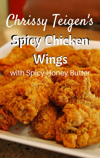 As The Chew hosts shared their favorite family-style recipes, Chrissy Teigen prepared her own remake of her husband John Legend's Spicy Chicken Wings with Spicy Honey Buter.