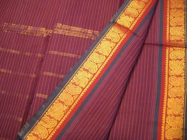 A Madurai cotton saree with the typical stripe print & gold border