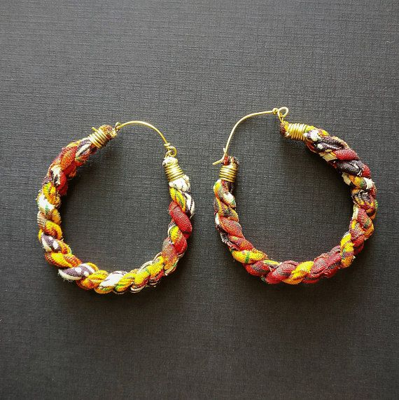 Very, very light. Classic hoop shape, made with African Wax Print fabric sourced from markets in Uganda, Burundi and Ghana. Earrings hang 6.3 cm (2.5 inches) from your piercing. 5.5 cm or 2.2 inches at widest point across the earring. These multicoloured fabric hoops add a