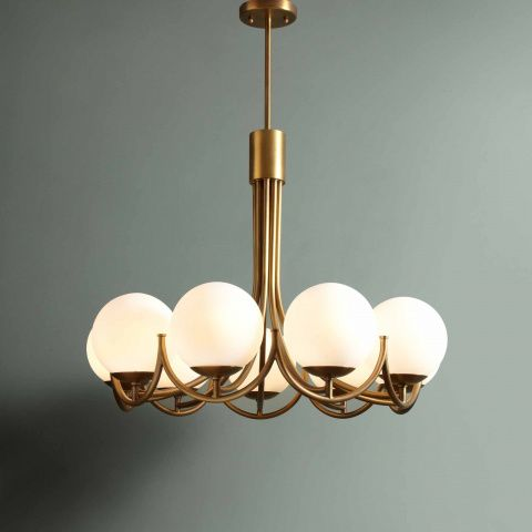 Inspired By New York Restaurants And Used In The Bedrooms At Soho House Chicago This Dramatic Chandelier Has Nine Opal Glass Globe Shades Antique Brass