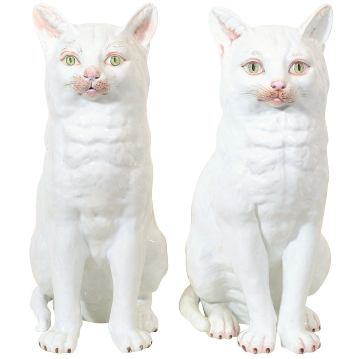 A Pair of Large White Porcelain Cats