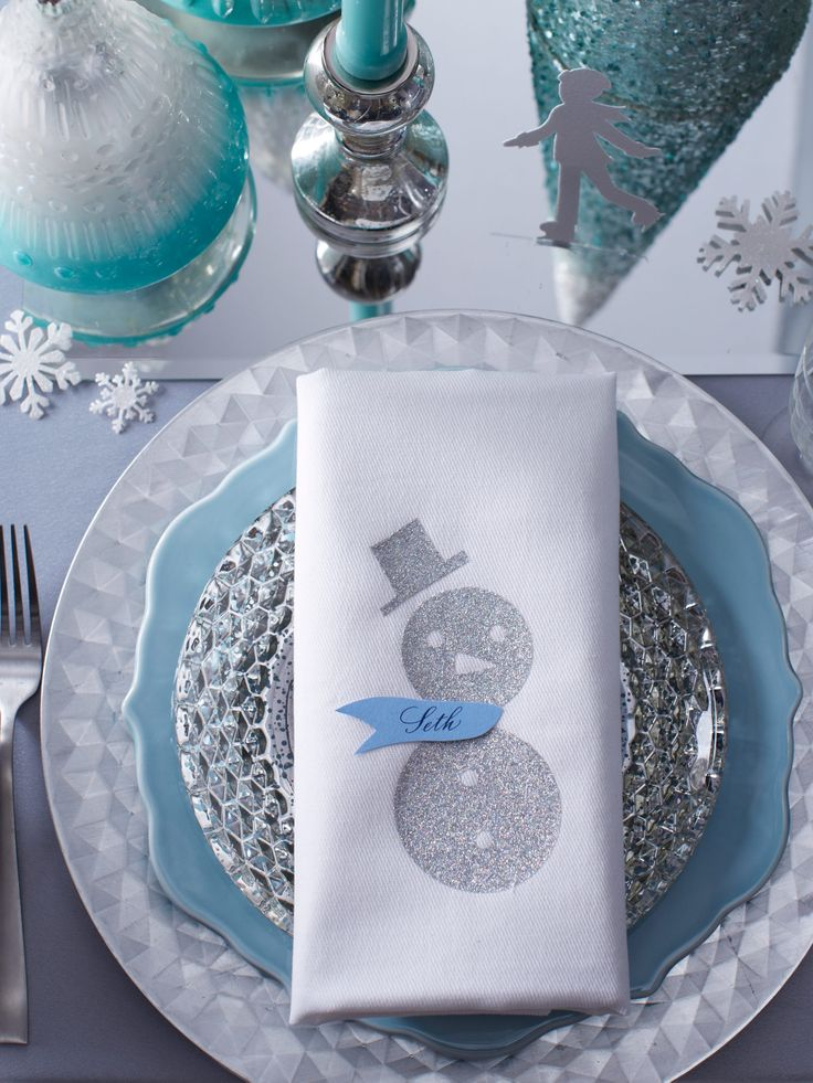 How-To: Update a simple, white napkin with an iron-on, snowy friend. Click for instructions.
