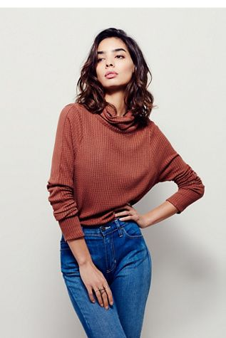 Would totally wear this. Cute and warm. I like how the sweater fits loosely, but retains some form fitting. I need more sweaters like that.