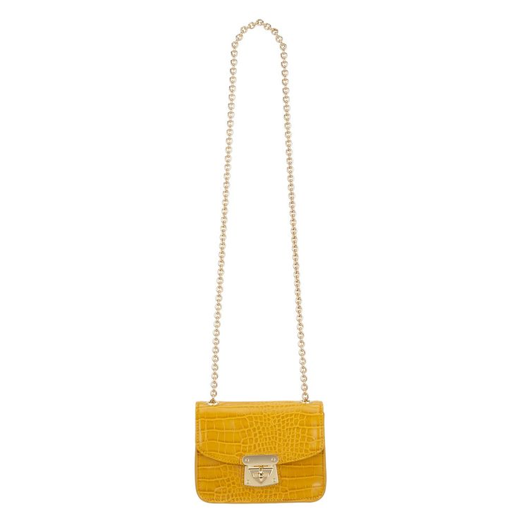 Our Hudson Mini Chain Bag is a chic example of easygoing elegance. It comes in a selection of colors and finishes—guaranteeing it'll match your style—and features a graphic buckle element on the closure. Adding to its versatility. A sleek gold chain for when you want to wear the Gigi as a shoulder bag instead of a clutch—we suggest trying it with a little black dress, and a night on the town. Material: Leather or Faux Embossed Croc LeatherDimensions: 8....