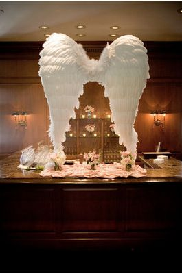 angel wings at a baby christening