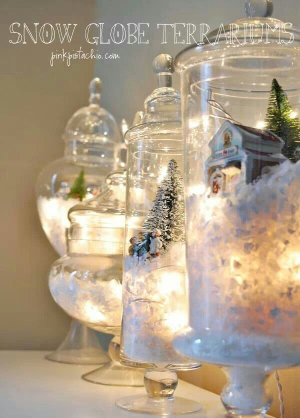 Homemade snow globe treasuries. I Would Love to Have a Bunch of  those Jars and Display All my Christmas Village Pieces in them! A New Beautiful Way of Displaying My Christmas village. I Love it!