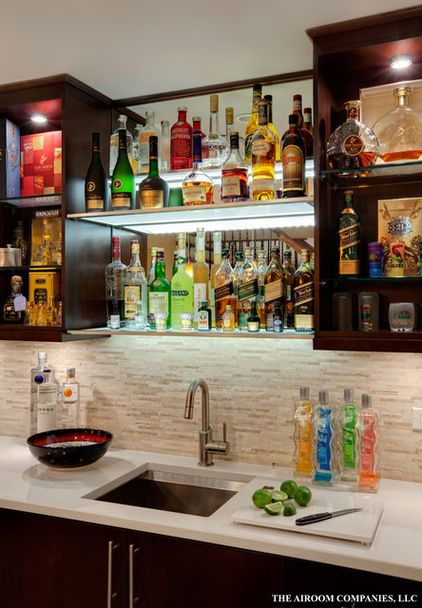 Lit glass shelving creates interest with the right amount and colors of bottles for a bar.  Can also be distracting if not stylized correctly.