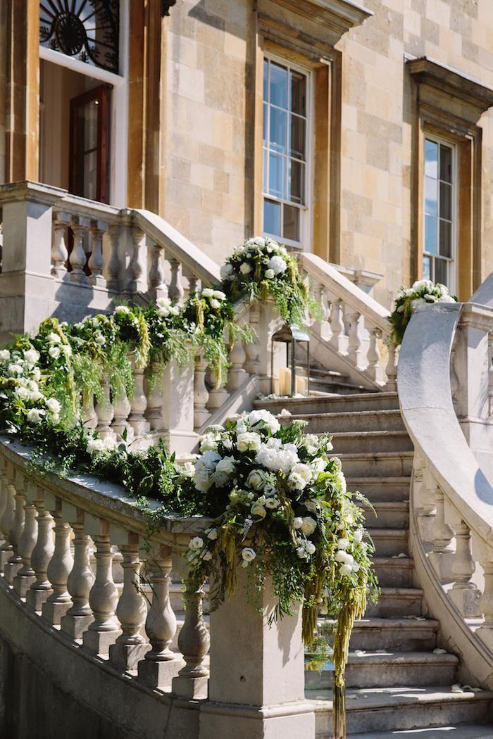 Floral Decor on the Stone Staircase #BotleysMansion #WeddingVenue #Surrey #BijouRealWedding #Stonestaircase #Stone #Flowers #WeddingFlowers