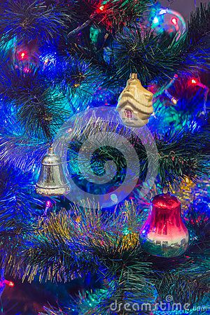 Vintage Christmas decorations on a blurred background.Vintage Christmas toys, bells of glass. Manufactured in the Soviet Union about the 50s of the 20th century.
