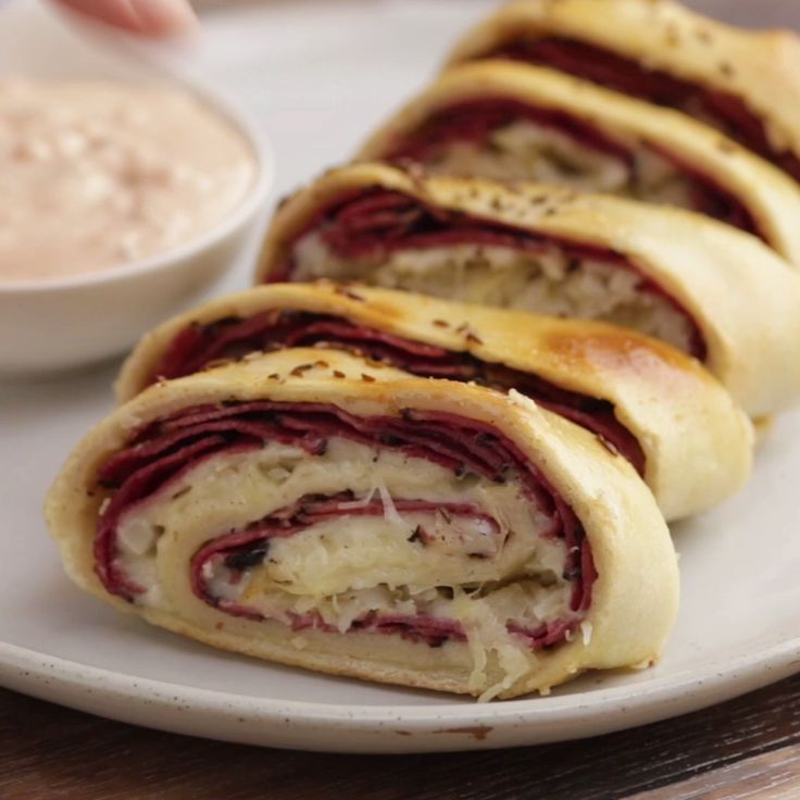 This recipe takes the best ingredients of a reuben sandwich and rolls it up into a cheesy pastrami stromboli. It makes a great dish for company because its easy to serve!