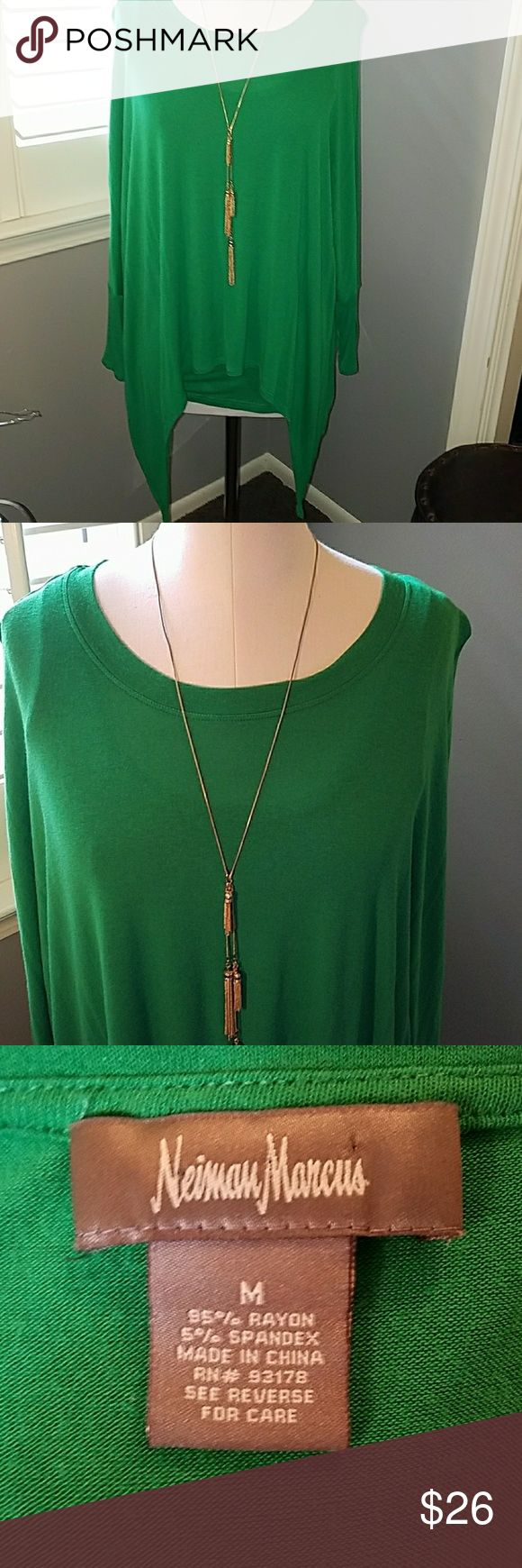 """Neiman Marcus Sharkbite hem, batwing sleeves M Built in tank under webbed arms and sharkbite hemline. Kelly green, rayon/spandex knit blend. (necklace not for sale) Measurements for the tank part of the top taken laying flat without stretching. Armpit to armpit 15.5"""", waist 14.25"""", hips/hemline 18.25"""", length from top of shoulder to hemline 29.5"""" Neiman Marcus Tops"""